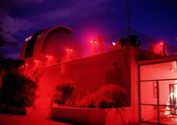 The George Observatory under low red light.