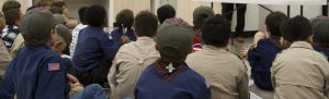 A group of Boy Scouts learning in one of the Houston Museum of Natural Science Scout Camp classrooms.