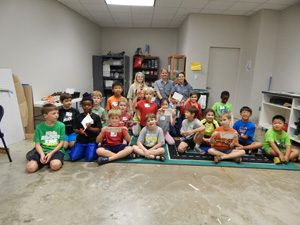 A group of kids attending one of the most interactive camps in houston with HMNS.