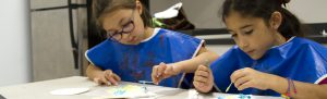 Girl scouts working with arts and crafts at the Houston Museum of Natural Science scout camp.
