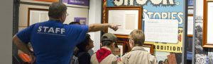 Boy Scouts with Houston Museum of Natural Science staff in one of the school classes.