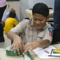 A Boy Scout working a classroom project in the museum School-year classes.