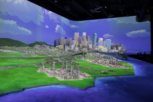 A projection mapped scale model of energy city in the Weiss Hall.