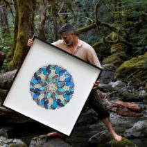 Christopher Marley holds up one of his artwork pieces from Biophilia.