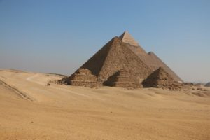 Image shows the pyramids of giza in egypt