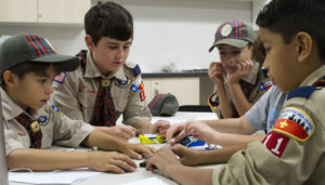 Boy scouts working in a classroom setting.