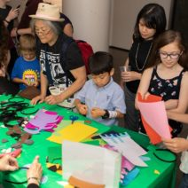 A family enjoying crafts and activities at a museum event.