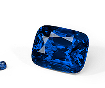 One of the world's largest blue ceylon sapphires sits next to a more common 10 carat sapphire.