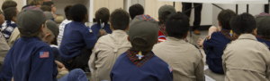 A group of boy scouts in the merit badge on demand program looking on at instruction.