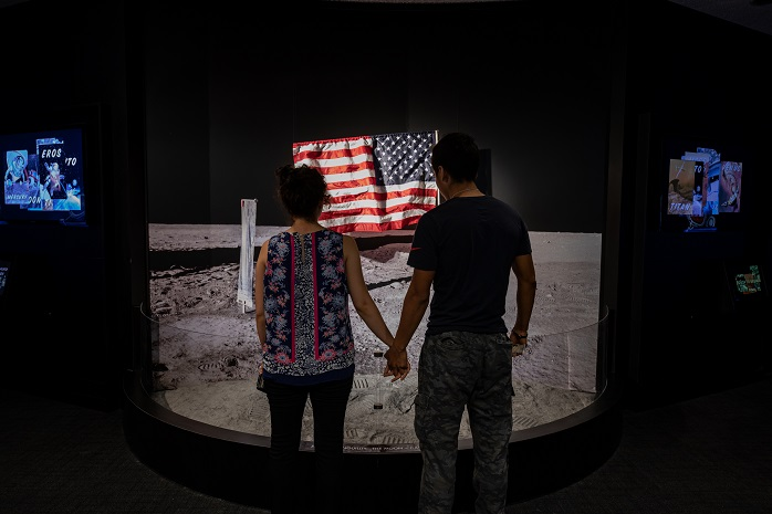 During the 50th anniversary of apollo 11, a couple stands in front of a recreation of the sea of tranquility, the site of the first moon landing.