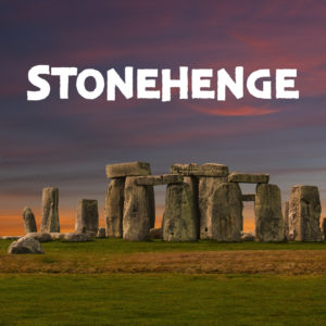 The megalithic site stonehenge in front of a purple sunset.