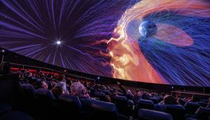 An audience views the planetarium dome in the Burke Baker Planetarium at HMNS.